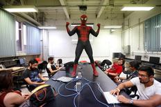 Moises Vazquez, 26, known as Spider-Moy, a computer science teaching assistant at the Faculty of Science of the National Autonomous University of Mexico (UNAM), who teaches dressed as a comic superhero Spider-Man, poses for a photograph during a class in Mexico City, Mexico, May 27, 2016. REUTERS/Edgard Garrido