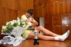Tennis - French Open Women's Singles Final match - Roland Garros - Serena Williams of the U.S. vs Garbine Muguruza of Spain- Paris, France - 04/06/16 Garbine Muguruza holds trophy.  REUTERS/Corinne Dubreuil/FFT/Pool