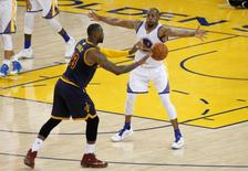 June 2, 2016; Oakland, CA, USA; Golden State Warriors forward Andre Iguodala (9) defends against Cleveland Cavaliers forward LeBron James (23) during the second half in game one of the NBA Finals at Oracle Arena. Mandatory Credit: Cary Edmondson-USA TODAY Sports