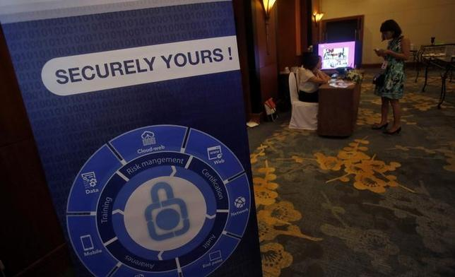 An advertising billboard of a cyber security company is seen during the annual Banking Vietnam 2016 forum in Hanoi, Vietnam May 19, 2016. REUTERS/Kham/Files