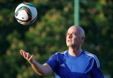 FIFA President Gianni Infantino plays with a ball during a friendly soccer match between 2018 World Cup Organising Committee and Rosich-Starco team of Russian politicians and pop stars in Moscow, Russia, June 1, 2016.  REUTERS/Maxim Shemetov