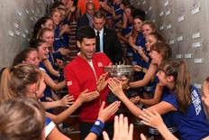 Tennis - French Open Mens Singles Final match - Roland Garros - Novak Djokovic of Serbia vs Andy Murray of Britain - Paris, France - 05/06/16.  Novak Djokovic celebrates with ball girls. REUTERS/Nicolas Gouhier/FFT/Pool
