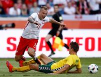Football Soccer - Poland v Lithuania - International Friendly - Municipal stadium, Krakow, Poland - 6/6/16 - Poland's Kamil Grosicki and Lithuania's Edvinas Girdvainis in action. REUTERS/Kacper Pempel