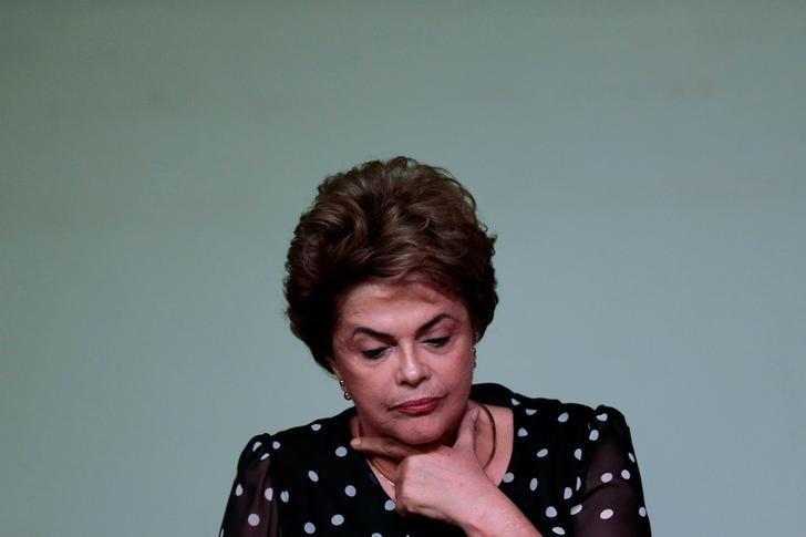 Suspended Brazilian President Dilma Rousseff gestures during the launching ceremony of the book ''Resistance to the 2016 Coup,'' written by professors from the University of Brasilia, in Brasilia, Brazil, May 30, 2016. REUTERS/Ueslei Marcelino