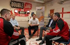 Britain's Prince Harry (C) meets members of the club and the foundation 'Sported' during a visit to the Double Jab Boxing Club in South East London on June 6, 2016 to support Sport for Social Development initiatives. REUTERS/Daniel Leal-Olivas/Pool