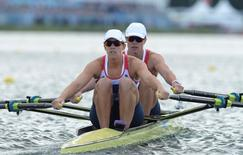 Katherine Grainger and Anna Watkins of Britain row on their way to winning the women's Double Sculls final during the London 2012 Olympic Games at Eton Dorney August 3, 2012.  REUTERS/Pool