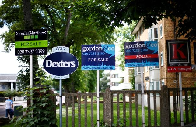 Estate agents boards are lined up outside houses in south London, Britain June 3, 2014.   REUTERS/Andrew Winning/File Photo