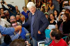 "U.S. actor Richard Gere (C) arrives to attend a news conference to present his movie ""Time Out of Mind"" in the soup kitchen run by the Sant'Egidio Christian community in Rome, Italy June 9, 2016. REUTERS/Tony Gentile"