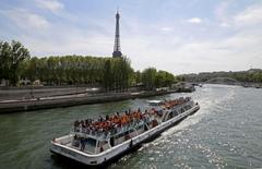 File photo of a Paris tour boat which makes its way along the Seine River near the Eiffel Tower on a sunny spring day in Paris, France, May 8, 2016. REUTERS/Jacky Naegelen/File Photo