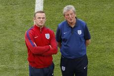 Football Soccer - England Training Marseille, France - 10/6/16 England manager Roy Hodgson and Wayne Rooney walk on the pitch ahead of their match REUTERS/Eddie Keogh Livepic