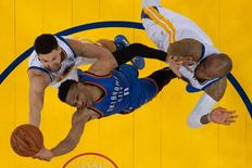 May 30, 2016; Oakland, CA, USA; Oklahoma City Thunder guard Russell Westbrook (0) shoots the basketball against Golden State Warriors guard Klay Thompson (11) and center Marreese Speights (5) during the first half of game seven of the Western conference finals of the NBA Playoffs at Oracle Arena. The Warriors defeated the Thunder 96-88. Mandatory Credit: Kyle Terada-USA TODAY Sports