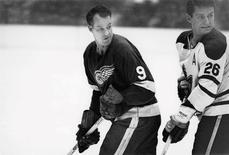 Detroit Red Wings' Gordie Howe (L) is pictured in action against the Toronto Maple Leafs' Allan Stanley in this undated handout photo.  Detroit Red Wings/Handout via REUTERS