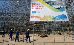 "Workers are pictured at the construction site of the beach volleyball venue for 2016 Rio Olympics on Copacabana beach in Rio de Janeiro, Brazil, June 9, 2016. The sign reads, ""Future Olympic installation"". REUTERS/Sergio Moraes"