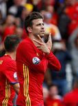Zagueiro espanhol Gerard Piqué comemorando gol em partida contra República Tcheca pela Euro.    13/06/2016     REUTERS/Sergio Perez Livepic