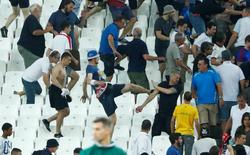 England fans try to escape trouble in the stadium at full time after the match against Russia. REUTERS/Eddie Keogh Livepic