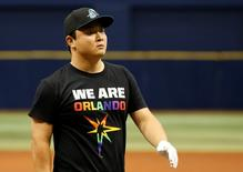 """Tampa Bay Rays catcher Hank Conger (24) wears a """"We Are Orlando"""" shirt in wake of the Orlando attack prior to the game against the San Francisco Giants  at Tropicana Field. Mandatory Credit: Kim Klement-USA TODAY Sports - RTX2GV1U"""