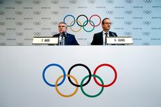 International Olympic Committee (IOC) President Thomas Bach gives a news conference with Mark Adams, IOC Chief of Communications, after the Olympic Summit on doping in Lausanne, Switzerland, June 21, 2016.  REUTERS/Denis Balibouse