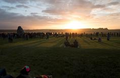 Revellers celebrate the summer solstice at Stonehenge on Salisbury Plain in southern England, Britain June 21, 2016.  REUTERS/Kieran Doherty