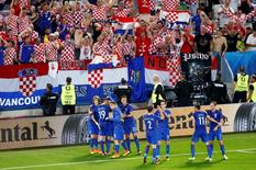 Football Soccer - Croatia v Spain - EURO 2016 - Group D - Stade de Bordeaux, Bordeaux, France - 21/6/16 Croatia's Ivan Perisic celebrates after scoring their second goal with teammates REUTERS/Regis Duvignau