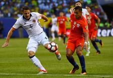 Jun 22, 2016; Chicago, IL, USA; Colombia defender Santiago Arias (4) and Chile forward Alexis Sanchez (7) fight for the ball during the first half in the semifinals of the 2016 Copa America Centenario soccer tournament at Soldier Field. Mandatory Credit: Mike DiNovo-USA TODAY Sports