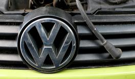 A Volkswagen (VW) logo is seen on a car's front at a scrapyard in Fuerstenfeldbruck, Germany, May 21, 2016.    REUTERS/Michaela Rehle/File Picture