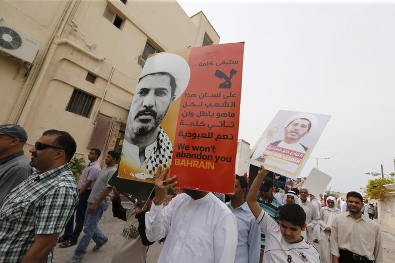 Protesters hold banners with photos of opposition leader and head of Al Wefaq party Ali Salman saying ''We won't abandon you Bahrain'' during a protest after Friday prayers in the village of Diraz west of Manama, Bahrain, March 11, 2016.  REUTERS/Hamad I Mohammed