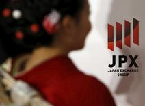 A logo of Japan Exchange Group Inc. is seen next to a woman, dressed in ceremonial kimono, before the New Year opening ceremony at the Tokyo Stock Exchange (TSE), held to wish for the success of Japan's stock market, in Tokyo, Japan, January 4, 2016.   REUTERS/Yuya Shino/File Photo