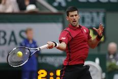 Tennis - French Open Mens Singles Final match - Roland Garros - Novak Djokovic of Serbia vs Andy Murray of Britain - Paris, France - 05/06/16. Novak Djokovic returns the ball. REUTERS/Benoit Tessier