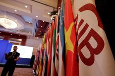 Flags of Asian Infrastructure Investment Bank (AIIB) (R) and member states are set up for the opening ceremony of the first annual meeting of AIIB in Beijing, China, June 25, 2016. REUTERS/Jason Lee
