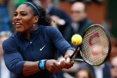 Tennis - French Open Women's Singles Final match - Roland Garros - Serena Williams of the U.S. vs Garbine Muguruza of Spain- Paris, France - 04/06/16   Serena Williams returns the ball. REUTERS/Pascal Rossignol