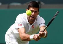 Britain Tennis - Wimbledon - All England Lawn Tennis & Croquet Club, Wimbledon, England - 27/6/16 Serbia's Novak Djokovic in action against Great Britain's James Ward REUTERS/Paul Childs