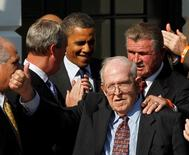 Chicago Bears Defensive coach Buddy Ryan gives a thumbs-up as U.S. President Barack Obama honors the Super Bowl-winning 1985 Chicago Bears NFL team at the White House in Washington, DC, United States October 7, 2011.    REUTERS/Jason Reed/File Photo