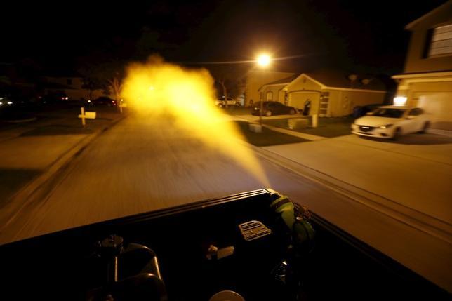 Hillsborough County mosquito control drives through a neighborhood spraying against mosquitos in Hillsborough County, Florida, February 2, 2016. REUTERS/Scott Audette