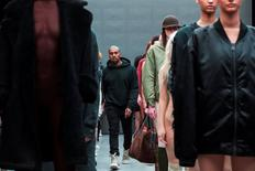 Singer Kanye West walks past models after presenting his Fall/Winter 2015 partnership line with Adidas at New York Fashion Week, U.S. February 12, 2015.  REUTERS/Lucas Jackson/File photo
