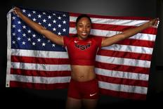 Runner Allyson Felix poses for a portrait with the U.S. flag at the U.S. Olympic Committee Media Summit in Beverly Hills, Los Angeles, California March 7, 2016. REUTERS/Lucy Nicholson