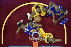 Jun 9, 2015; Cleveland, OH, USA; Golden State Warriors forward Harrison Barnes (40) and center Festus Ezeli (31) go for a rebound against Cleveland Cavaliers center Tristan Thompson (13) and forward James Jones (1) in game three of the NBA Finals at Quicken Loans Arena. Mandatory Credit: Bob Donnan-USA TODAY Sports -