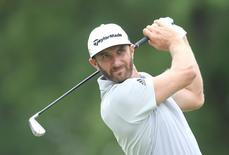 Jul 2, 2016; Akron, OH, USA;  Dustin Johnson of the United States hits his tee shot on the on the third hole  during the third round of the Bridgestone Invitational at Firestone Country Club - South Course. Mandatory Credit: Charles LeClaire-USA TODAY Sports