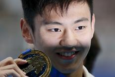 Ning Zetao of China poses with his gold medal after winning the men's 100m freestyle final at the Aquatics World Championships in Kazan, Russia August 6, 2015.  REUTERS/Stefan Wermuth