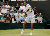 Britain Tennis - Wimbledon - All England Lawn Tennis & Croquet Club, Wimbledon, England - 4/7/16 Croatia's Marin Cilic in action against Japan's Kei Nishikori REUTERS/Stefan Wermuth