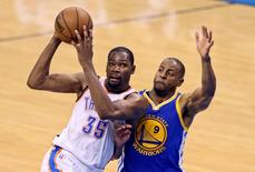 May 24, 2016; Oklahoma City, OK, USA; Oklahoma City Thunder forward Kevin Durant (35) drives to the basket as Golden State Warriors forward Andre Iguodala (9) defends during the second half in game four of the Western conference finals of the NBA Playoffs at Chesapeake Energy Arena. Mandatory Credit: Kevin Jairaj-USA TODAY Sports/File Photo