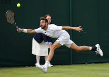 Britain Tennis - Wimbledon - All England Lawn Tennis & Croquet Club, Wimbledon, England - 30/6/16 Spain's Marcel Granollers in action against France's Richard Gasquet REUTERS/Stefan Wermuth