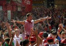 Revellers celebrate during the start of the San Fermin festival in Pamplona, Spain July 6, 2016. REUTERS/Eloy Alonso