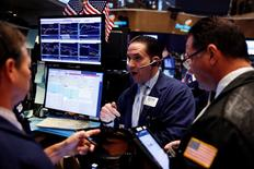 Traders work on the floor of the New York Stock Exchange (NYSE) shortly after the opening bell in New York, U.S., July 6, 2016.  REUTERS/Lucas Jackson