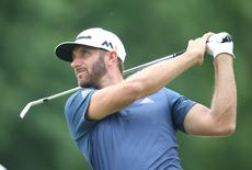 Jul 3, 2016; Akron, OH, USA;  Dustin Johnson of the United States hits a tee shot on the twelfth hole during the final round of the 2016 Bridgestone Invitational at Firestone Country Club - South Course. Mandatory Credit: Charles LeClaire-USA TODAY Sports