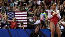 Jul 10, 2016; San Jose, CA, USA; Gabby Douglas waits to compete in the floor exercise during the women's gymnastics U.S. Olympic team trials at SAP Center. Mandatory Credit: Robert Hanashiro-USA TODAY Sports