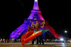 Portugal fans react near the Eiffel Tower after their team won in the Portugal v France EURO 2016 final soccer match in Paris, France, July 11, 2016. REUTERS/Stephane Mahe