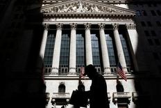 A man passes by the New York Stock Exchange (NYSE) in New York City, U.S., July 11, 2016.  REUTERS/Brendan McDermid