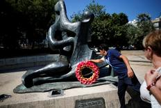 Israeli windsurfer Shahar Tzuberi, who will represent Israel at the 2016 Rio Olympics, lays a wreath during a memorial ceremony for the 11 Israeli team members who were killed by Palestinian gunmen during the 1972 Summer Olympics in Munich, in Tel Aviv, Israel July 13, 2016. REUTERS/Amir Cohen
