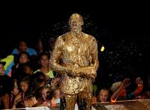 "Retired NBA basketball player Kobe Bryant reacts after he was ""slimed"" after accepting the ""Legend"" award at the Kids Choice Sport 2016 awards in Los Angeles, California U.S., July 14, 2016.  REUTERS/Mario Anzuoni"