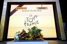 Cycling - Tour de France cycling race - The 37.5 km (23.3 miles) Stage 13 from Bourg-Saint-Andeol to La Caverne du Pont-d'Arc, France - 15/07/2016 - Flowers lay on the podium after riders and officials observed a minute of silence to the victims of Nice truck attack on Bastille Day.    REUTERS/Juan Medina